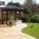 Patio in Tobermore Pietra Sandstone Buff with Kerbstone risers to edge  (05-06-2008)